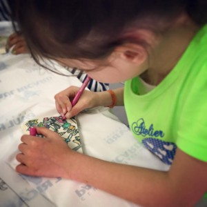 Child coloring in an art class.